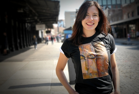 Actress Gemma Forbes rocking the RE:ARTISTE T-shirt inspired by whimsical and quirky art of Maria Kviklis