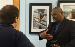 """Bill Jones welcome the guests at his solo show, """"Celebrating Keansburg""""."""