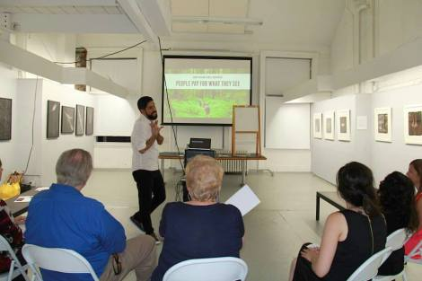 At the coaching session for artists: RE:ARTISTE with coach Leo Rapini and the artists at Soho Photo Gallery