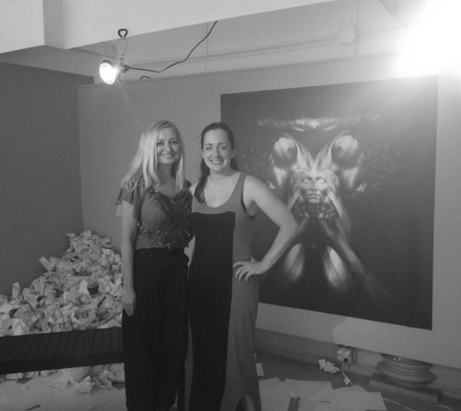 Curator Natalie Burlutskaya (RE:ARTISTE) and artist and playwright, Brooke M. Haney; Art by Kate Goltseva
