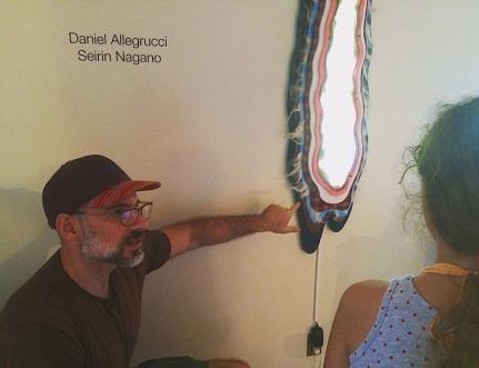 Daniel Allegrucci explaining his artwork